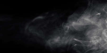 Abstract image of white smoke or mist in black background. 版權商用圖片