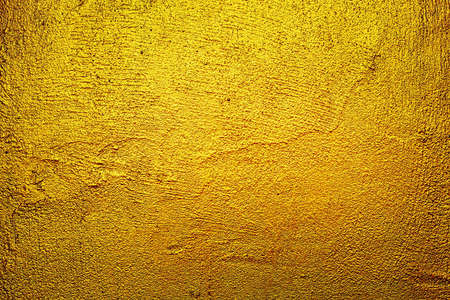 Abstract image of Empty space concrete wall grunge texture background with golden gradient lighting effect. 版權商用圖片