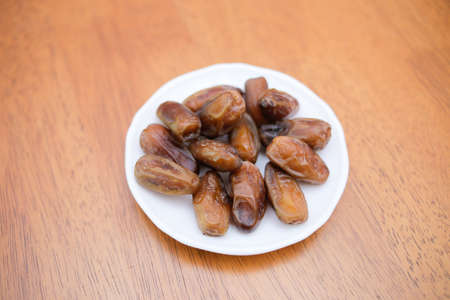 Date palm fruit or kurma on top of the dish Stock Photo