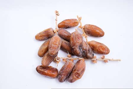 Kurma or dates fruits isolated on white background