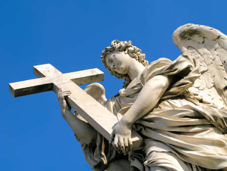 angel statue: Statue of an angel holding a cross outside of Castel SantAngelo in Rome, Italy. Stock Photo