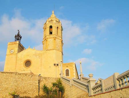 17th: 17th century seaside church of Sant Bartomeu in Sitges near Barcelona, Spain. Stock Photo