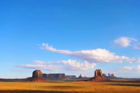butte: View of Monument Valley from Artists Point.  Merricks Butte (L) and East Mitten Butte (R) in the foreground.