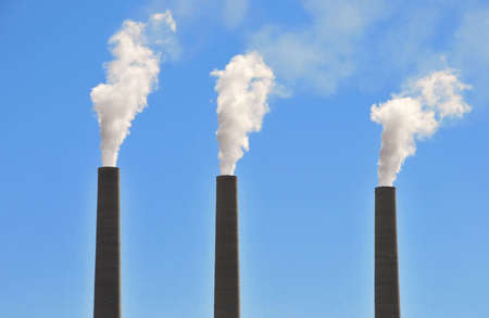 Three chimneys from coal-fired powerplant in Page, Arizona with blue sky background. Stock Photo - 4656786