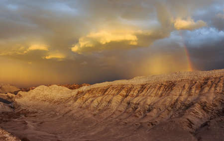 Thunderstorm developing over sand dune in Valle De La Luna in the Atacama Desert near San Pedro de Atacama, Chile. The Atacama Desert is one of the driest places on earth, and these storms are rare. photo