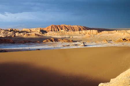 atacama: Thunderstorm developing over sand dune in Valle De La Luna in the Atacama Desert near San Pedro de Atacama, Chile. Stock Photo