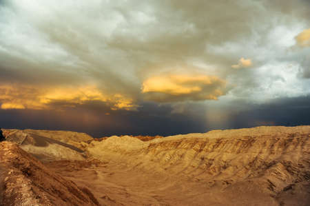 Thunderstorm developing over sand dune in Valle De La Luna in the Atacama Desert near San Pedro de Atacama, Chile. photo