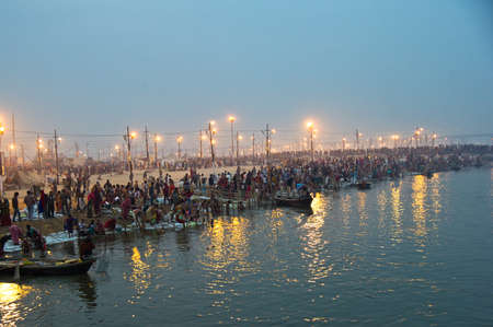 ganges: Pilgrims arriving to take a holy bath in the Ganges River in Allahabad for Kumbh Mela Festival