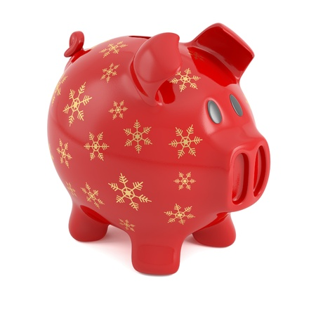 red piggy bank decorated with golden snowflakes photo