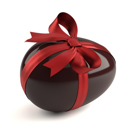 chocolate easter egg with red ribbon photo