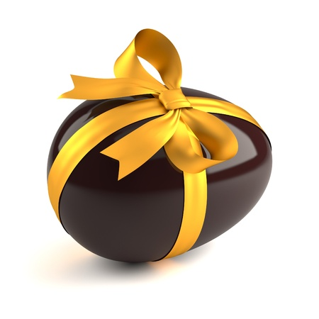 chocolate easter egg with yellow ribbon photo