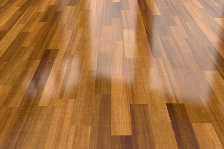 laminate flooring: Close-up view of dark wood parquet floor, background