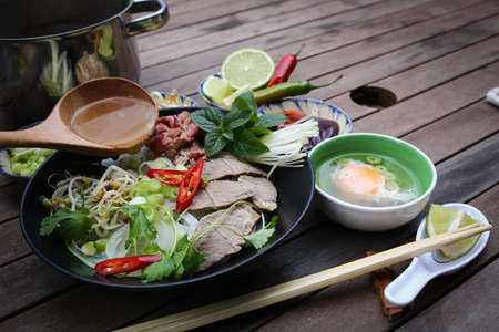 hoisin sauce: Vietnamese rice noodles are served with beef, lime, hoisin sauce and chili sauce and ready to eat  Stock Photo