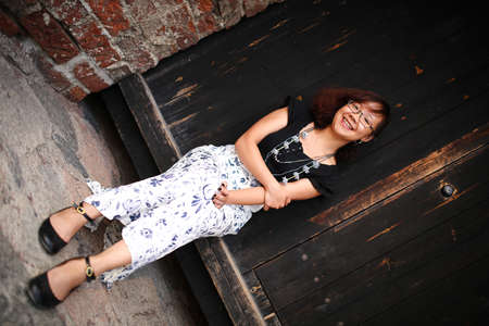 maxi: Young and happy asian woman with glasses and maxi skirt