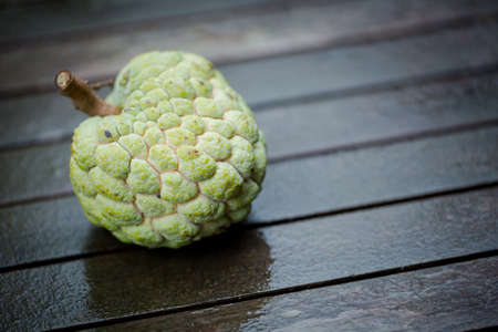 squamosa: Annona squamosa or sugar-apple on a rustic wooden background Stock Photo