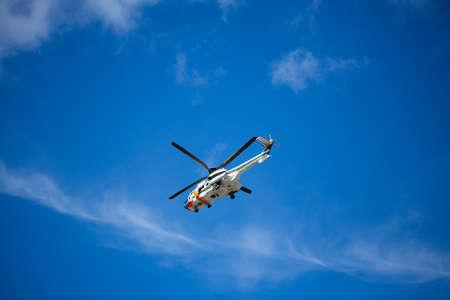 turku: TURKU, FINLAND - MAY 09: Finnish ambulance helicopter in the sky. May 09, 2015 in Turku, Finland. Editorial