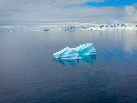 floating iceberg in north pole and frozen mountains