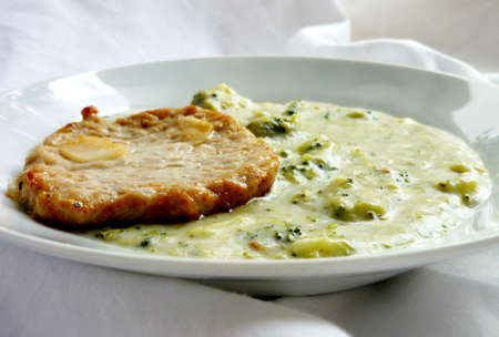 pork chop: Pork chop with broccoli pottage, made with cream and smoked cheese