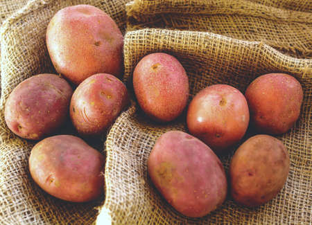 sackcloth: Potatoes on sackcloth Stock Photo