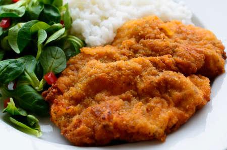schnitzel: Schnitzel, salad and rice - detail