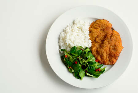 rice plate: Schnitzel, salad and rice top view
