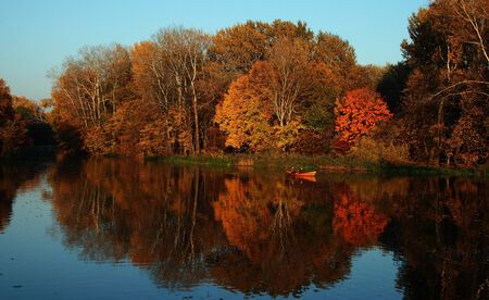 wilanow: Beautiful colorful autumn over the water Stock Photo