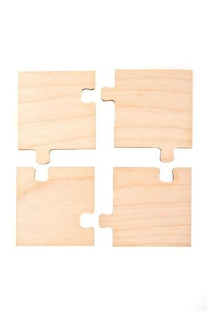 Four wooden puzzle on a white background