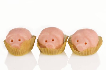 Three marzipan pigs on a white background Stock Photo
