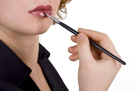 Applying lip makeup with a brush photo