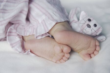 Feet of a sleeping toddler Stock Photo