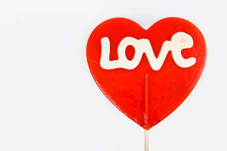 Love lollipop on a white background Stock Photo