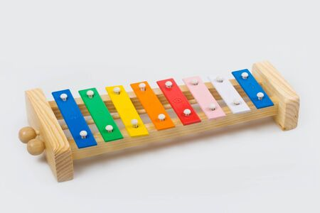 Wooden xylophone on a white background