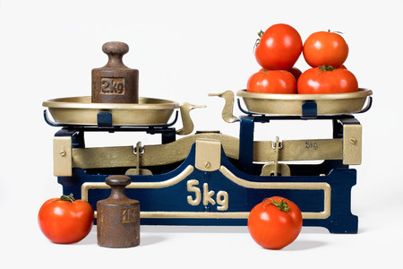 old fashioned vegetables: Tomatoes on a retro scale Stock Photo