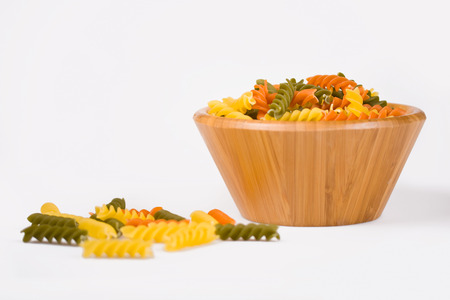 Wooden bowl with fusilli pasta 写真素材