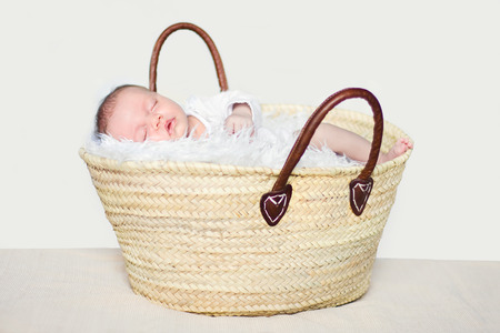 Baby girl sleeping in a shopping basket