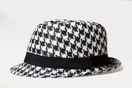 houndstooth: Hat with a houndstooth pattern on a white background Stock Photo
