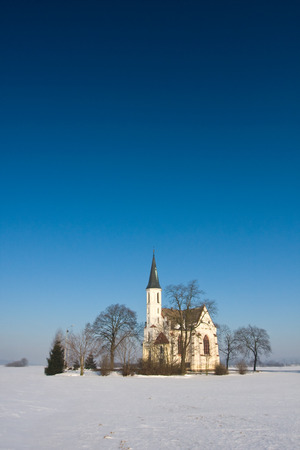 Winter landscape with a church Poland.