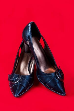 pointy: Black shoes on a red background