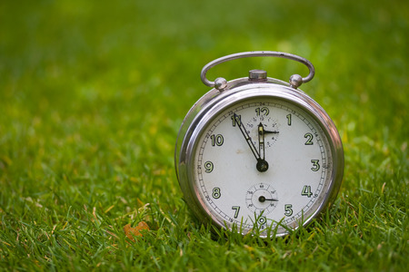 Clock on a green grass