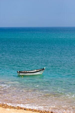 atlantic: Boat on an Atlantic Ocean in Portugal. Stock Photo