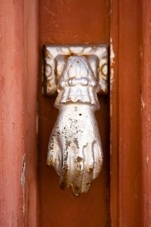 doorknocker: Fatimas hand - doorknocker in Algarve, Portugal. Stock Photo