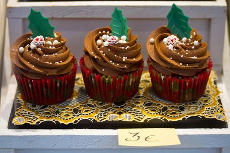 christmas cupcakes: Three Christmas cupcakes for sale Stock Photo