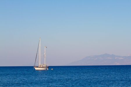 Lonely boat on an Aegean sea Stock Photo