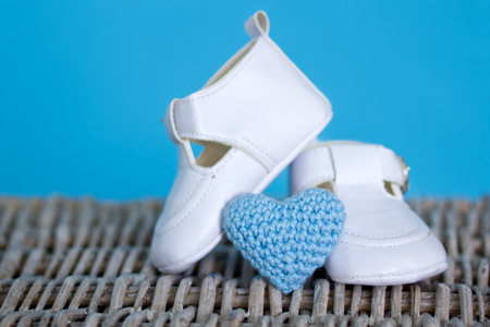 Pair of white baby shoes