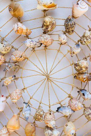 Shells on a net decoration. Greece. Stock Photo