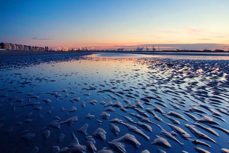 Zachód słońca na plaży w Belgii, Knokke.