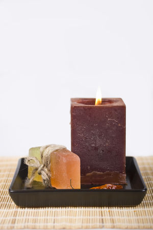 Soap and candle on a white background