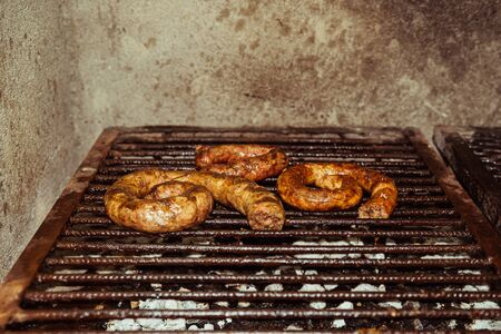 Traditional homemade sausages grilled coal and fire, traditional cuisine, Argentina.
