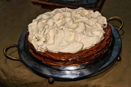 close up view of homemade dulce de leche and meringue cake. Selective focus.
