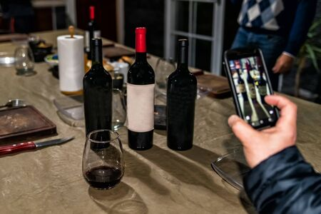 The concept of wine consumption. Wine bottles, glasses. Bottles of wine with space to writing.Space to write text.